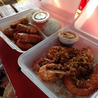 Photo taken at Romy's Kahuku Prawns & Shrimp Hut by Alicia D. on 11/4/2012