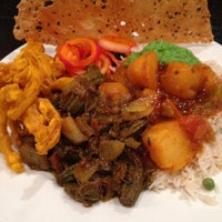 Photo taken at India Bistro Vancouver by Harry S. on 12/6/2014