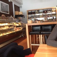 Photo taken at La Fromagerie by Karol G. on 1/31/2014