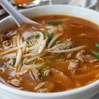 Photo taken at Srisiamchai Thai Restaurant by Nayoen K. on 2/5/2013