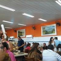 Photo taken at Churrascaria Bandeirantes by Carlos A. on 4/27/2014