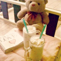 Photo taken at Chocolates and Creams Cafe by Chat L. on 9/5/2015