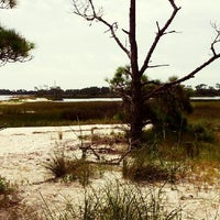 Photo taken at Saint George Island, FL by Mary S. on 6/10/2013