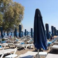 Photo taken at Parıltı Beach by Elif U. on 9/1/2014