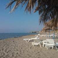 Photo taken at Kardamena Beach by Надежда К. on 6/9/2014