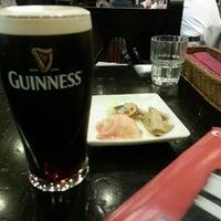 Photo taken at Irish Pub Stasiun (スタシェーン) 上野駅店 by Takashi M. on 5/21/2013