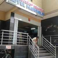 Photo taken at Mangala Hotel by Rupa J. on 5/3/2015