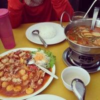 Photo taken at Phuket Thai Resto by Lina A. on 12/19/2014