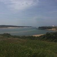 Photo taken at Praia de Vila Nova de Milfontes by Frederico V. on 4/10/2017
