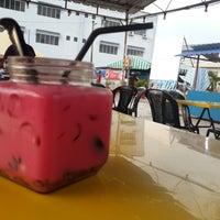 Photo taken at Uptown Parit Raja by Eyaa S. on 3/16/2015