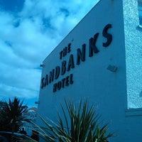 Photo taken at Sandbanks Hotel by Nuno M. on 4/13/2014