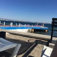 Photo taken at Alkoru Beach by Gökçe C. on 9/1/2016