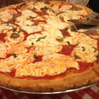 Photo taken at Lombardi's Coal Oven Pizza by Jessica P. on 12/11/2012
