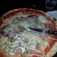 Photo taken at Karalis Pizzeria by Dominique N. on 3/16/2014