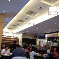 Photo taken at Mr Congee Chinese Cuisine 龍粥記 by Franco T. on 7/2/2014