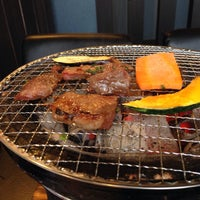 Photo taken at 炭火焼肉炭蔵 by Kazumine Y. on 1/8/2014