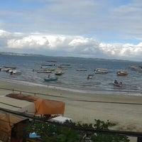 Photo taken at Praia de Paramana by Elaine S. on 3/4/2014