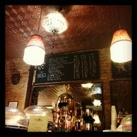 Photo taken at Tango Palace Coffee Company by Nilanthy B. on 3/24/2014