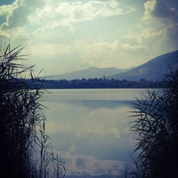 Photo taken at Lago di Annone by Alessandra D. on 7/6/2014