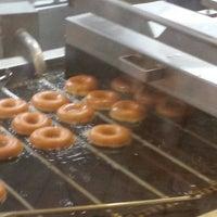 Photo taken at Krispy Kreme Doughnuts by Jamison B. on 5/4/2014