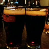 Photo taken at Milestones Grill & Bar by Olivia H. on 12/18/2015
