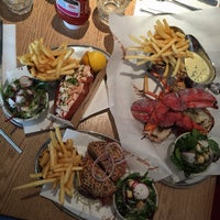 Photo taken at Burger & Lobster by Tommy C. on 4/2/2015