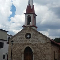 Photo taken at Iglesia de Nuestra Señora de Lourdes by Barbie S. on 7/24/2014