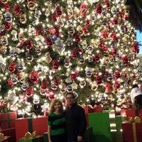 Photo taken at Fashion Island Gigantic Christmas Tree by Chris F. on 12/30/2013