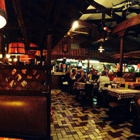 Photo taken at Dick Russell's Bar-B-Q by Taiyyib C. on 8/11/2014
