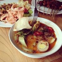 Photo taken at Kafe Betawi by cheb on 2/3/2014