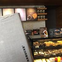 Photo taken at Starbucks by nicholas on 12/24/2017