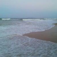 Photo taken at Batu burok beach by Csk K. on 3/13/2014