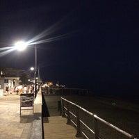 Photo taken at Playa Ferrara by Marta C. on 9/25/2016