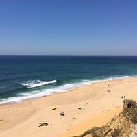 Photo taken at Praia das Bicas by Marta C. on 5/17/2014