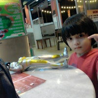 Photo taken at Popular Food Court by Khairunnisa A. on 5/11/2014