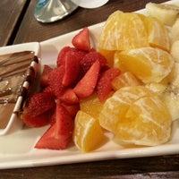 Photo taken at Theobroma Chocolate Lounge by Kelly K. on 10/7/2013
