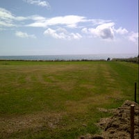 Photo taken at Ringstead Bay by Bryan O. on 8/18/2013