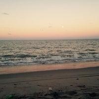 Photo taken at Praia Boca da Barra by Sinho O. on 4/3/2015