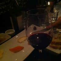 Photo taken at Mignon Wine & Cheese Bar by Michael S. on 2/26/2012