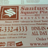 Photo taken at Santucci's Square Pizza and Restaurant by Marc P. on 5/30/2015