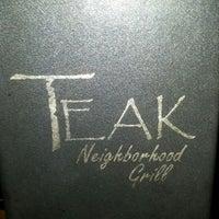 Photo taken at Teak Neighborhood Grill by Crystal K. on 2/13/2013