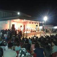 Photo taken at Gümüldür Amfi Tiyatrosu by Taylan G. on 8/8/2014
