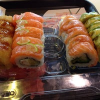 Photo taken at Sushi Blues Express by Camilo A. on 6/19/2014