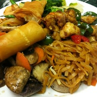 Photo taken at Thai Kitchen Cafe by Eric L. on 4/10/2013