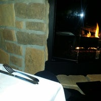 Photo taken at Toscanos Cafe & Wine Bar by Melvin J. on 5/26/2014