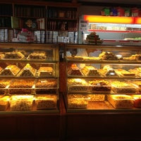 Photo taken at Samosa & Sweet Factory by Leanne E. on 7/27/2013