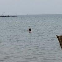 Photo taken at Pantai Pasir Putih by Arief L. on 2/25/2014