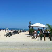 Photo taken at Oak Street Beach Food + Drink by Audra S. on 7/14/2013