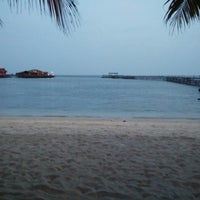 Photo taken at Derawan Beach Cafe & Cottage by Rully on 10/16/2014