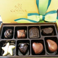 Photo taken at Godiva Chocolatier by Roslyn T. on 4/19/2015